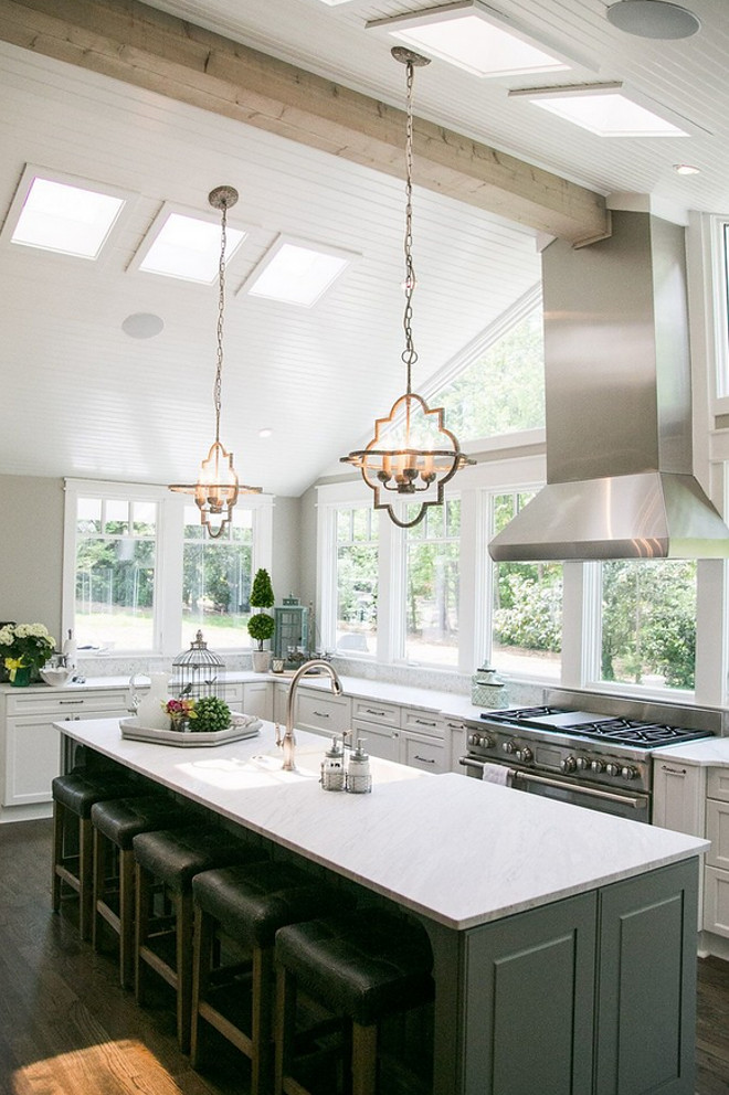 Kitchen vaulted ceiling with beam. The vaulted ceilings are shiplap painted in Sherwin Williams Alabaster. #SherwinWilliamsAlabaster #vaultedceiling #shiplapceiling #beam #ceiling Outrageous Interiorstchen-beamed-ceiling