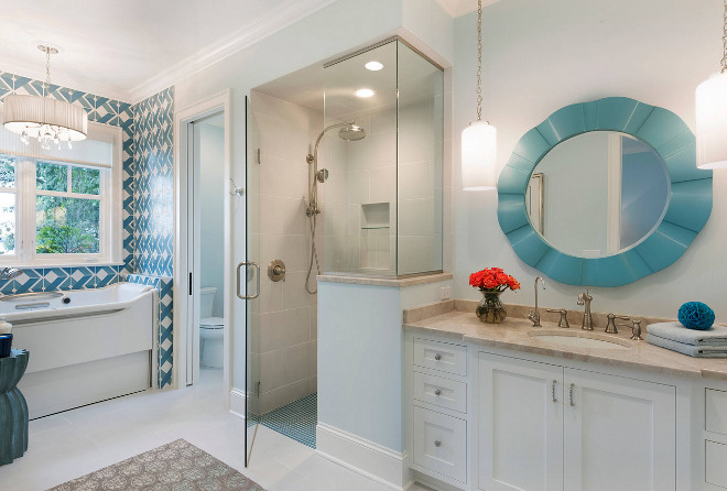 This bathroom feels feminine and fun. Can you guess the homeowner's favorite color? Turquoise looks great everywhere, doesn't it? Wall paint color is Benjamin Moore Winter Ice.