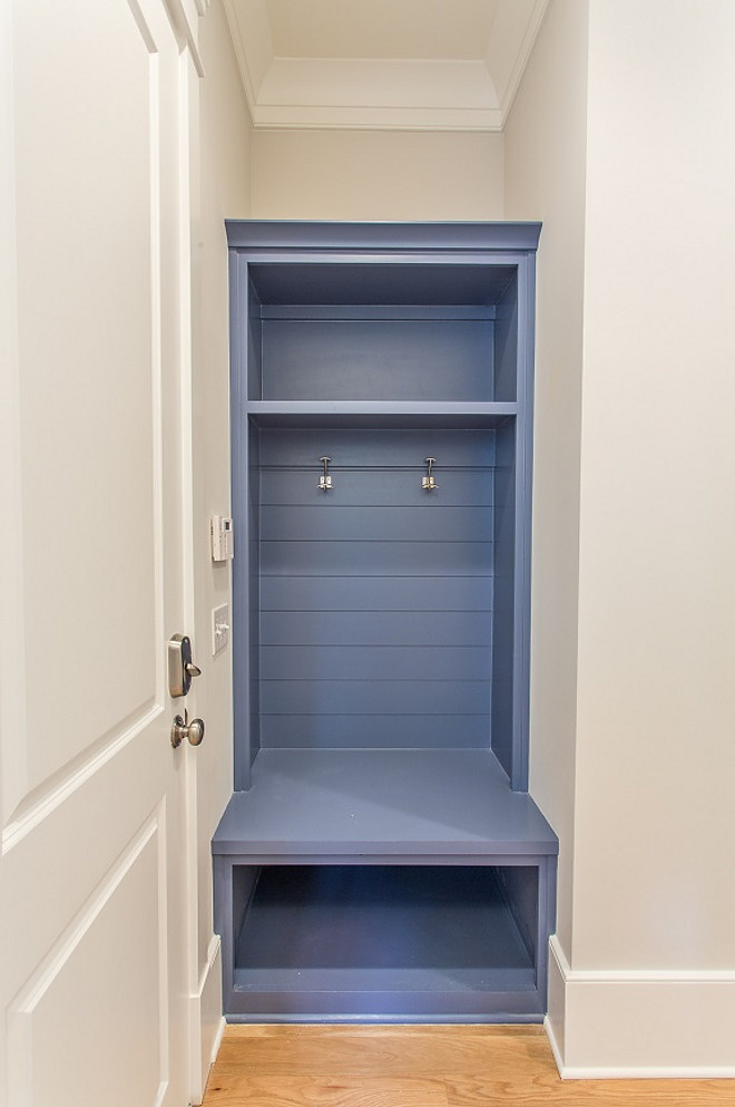 Blue Mudroom Cabinet. Small Blue Mudroom Cabinet. Space saving built-in blue mud room storage bench with tongue and groove paneling accented with nickel coat hooks below open cubby storage. #BlueMudroomCabinet #SmallBlueMudroomCabinet #BlueCabinet #mudroomcabinet #mudroom #cabinet #smallmudroom #smallinteriors #smallspaces