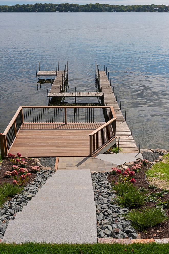 Steep lot dock. Great deck and dock idea for steep lots. #steeplots #steeplotideas #steeplotdock #steeplotdeck Stonewood LLC. Studio M Interiors. Spacecrafting Photography