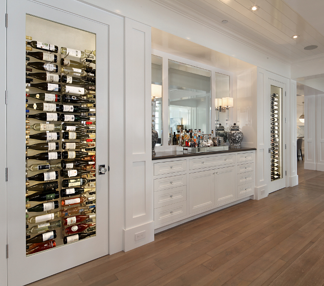 Built in wine cellar. The two temperature controlled wine closets and the built-in buffet were custom designed for this home. Built in wine cellar. Built in wine cellar. Dining room with Built in wine cellar. #Builtinwinecellar #winecellar Brandon Architects, Inc
