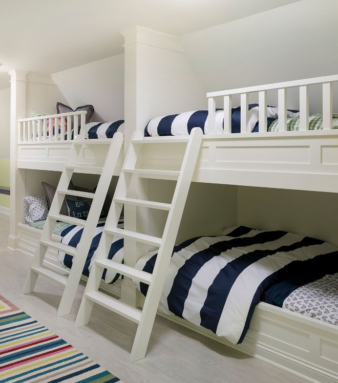 "Bunk beds. The custom built bunk beds feature wide ladders. Notice the classic millwork. Paint color is ""Benjamin Moore OC-17 White Dove"". #bunkbeds Stonewood LLC. Studio M Interiors. Spacecrafting Photography"