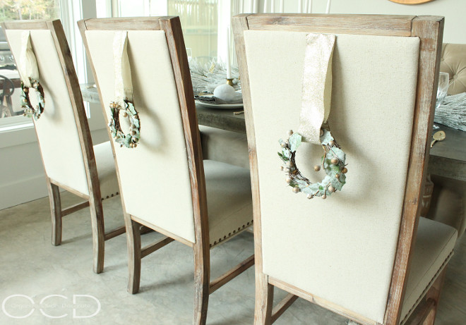 Chair Christmas Decor. Mini-Christmas wreathes add a festive look to the dining chairs. Chair Christmas Decor Ideas. Chair Christmas Decor. Chair Christmas Decor #ChairChristmasDecor Beautiful Homes of Instagram organizecleandecorate