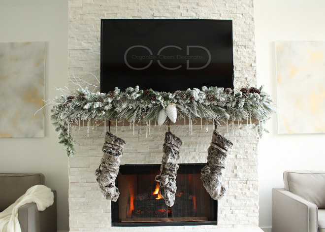 The neutral Christmas decor complements the white stone and the chunky wood mantel. Beautiful Homes of Instagram organizecleandecorate