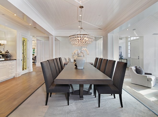 Dining room. The formal dining room is located between custom wine cellars and a living room. Dining room. Dining room <Dining room> #Diningroom Brandon Architects, Inc
