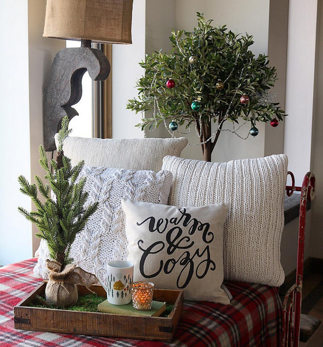 Farmhouse Christmas Decor. A rustic wood tray on a vintage day bed creates a cozy Christmas motiff. Farmhouse Christmas Decor. Farmhouse Christmas Decor Ideas #FarmhouseChristmasDecor #FarmhouseChristmasDecorIdeas #ChristmasDecor Home Bunch's Beautiful Homes of Instagram @birdie_farm