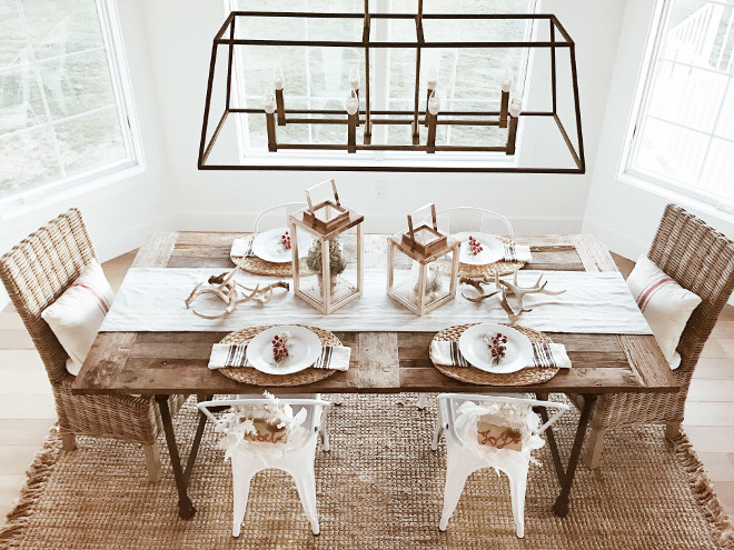 Farmhouse Dining Room. Farmhouse Dining Room with linear chandelier, rustic dining table, sisal rug and wicker chairs. #Farmhouse #DiningRoom #FarmhouseDiningRoom #linearchandelier #rusticdiningtable #sisalrug #wickerchairs Instagram Beautiful Homes of Instagram @NC_HomeDesign