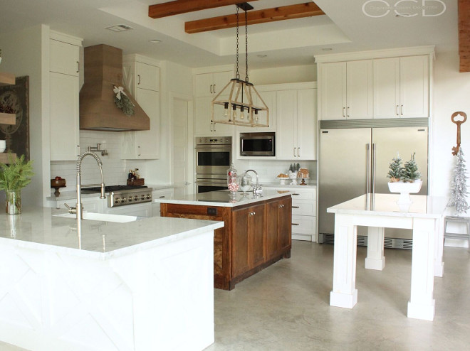 Farmhouse Kitchen. Farmhouse Kitchen. This farmhouse kitchen is truly a dream! I love the double islands and the cedar hood. Farmhouse Kitchen. Beautiful Farmhouse Kitchen with white cabinets and concrete flooring. <Farmhouse Kitchen> #FarmhouseKitchen Beautiful Homes of Instagram organizecleandecorate