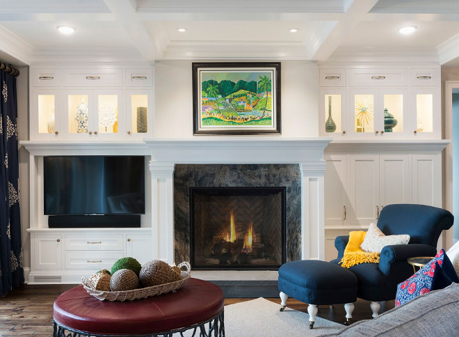 Living room fireplace cabinet. Custom cabinetry flanks the fireplace in this living room. #livingroom #fireplace #cabinet Stonewood LLC. Studio M Interiors. Spacecrafting Photography.