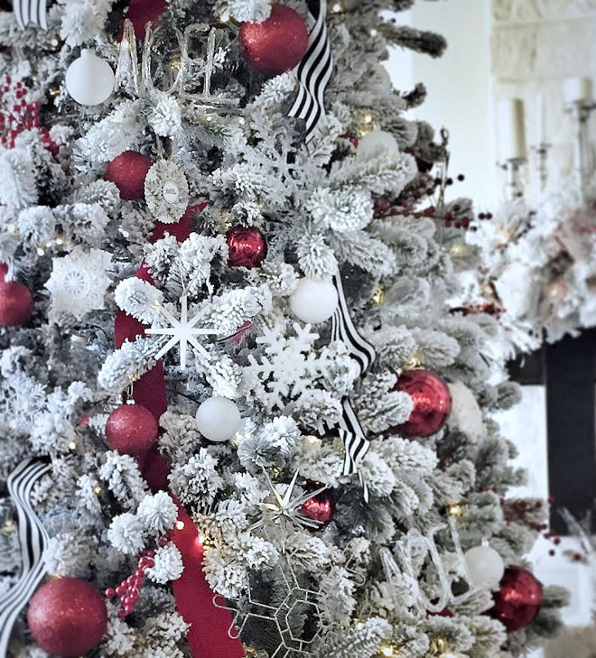 Flocked Christmas Tree Decorating Ideas. I love the pops of red on this fairly neutral Christmas tree! Flocked Tree Ornament Ideas. Flocked Christmas Tree Decorating Ideas. Flocked Tree Ornament Ideas #FlockedChristmasTreeDecoratingIdeas #ChristmasTreeDecoratingIdeas #FlockedTree #Ornaments #OrnamentIdeas MyTexasHouse