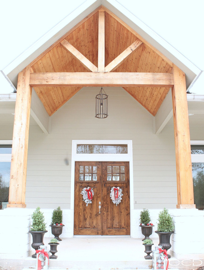 Front porch with exposed timbers. Front porch with exposed timbers and columns. Front porch with exposed timbers, timber columns, vaulted ceiling and double doors. # Frontporch #porch #exposedtimbers #timbercolumns #vaultedceiling #Doubledoors