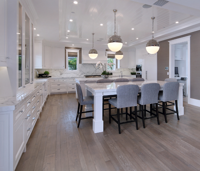 Kitchen two islands. Kitchen with two island. Kitchen with work island and eating island. Cabinets are paint graded Alder. Ceiling Treatment: T&G Semi-Gloss Lacquer Finish, painted in Dunn Edwards 380 White. Kitchen #Kitchen #islands Brandon Architects, Inc