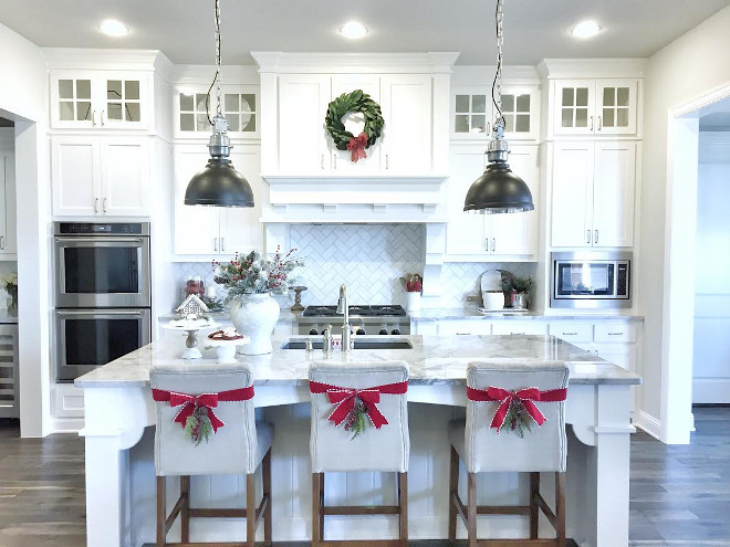 Kitchen Decorating Ideas. How to decorate your kitchen. In my kitchen, I added a Magnolia leaf wreath from Target on the vent hood and bows on the backs of the counter stools to give the space a cheery and festive feel! Kitchen Decorating Ideas. Kitchen Decorating Ideas #KitchenDecoratingIdeas #KitchenDecor #KitchenDecorIdeas #Christmas MyTexasHouse