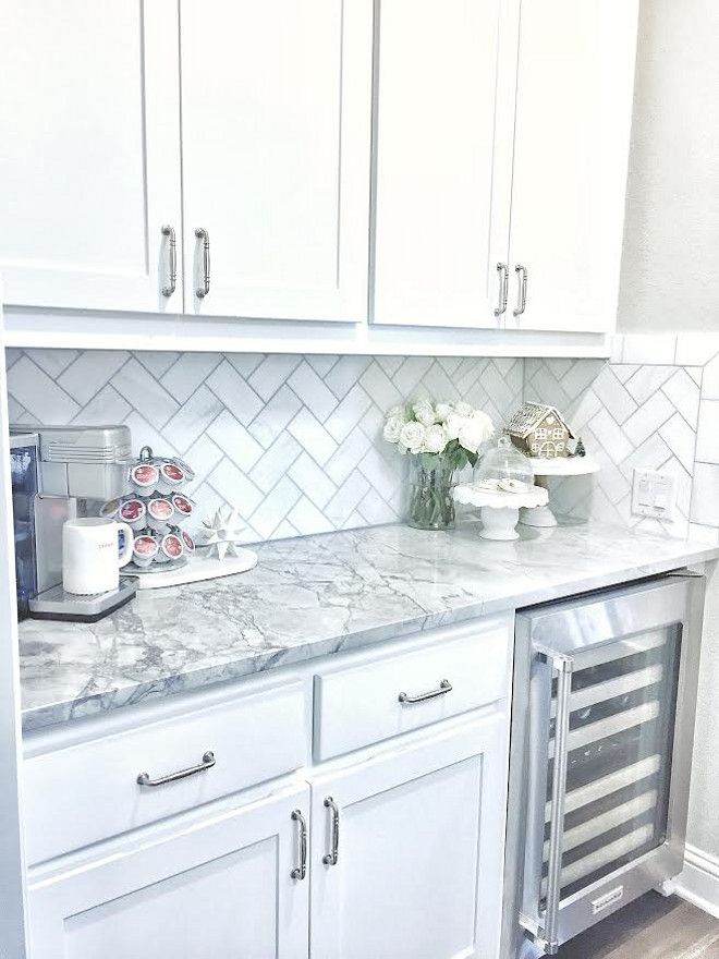 Kitchen Wet Bar Cabinet. Wet Bar Cabinet. The wet bar features white cabinet, herringbone backsplash and white quartzite countertop. The backsplash is Daltile m313 contempo white marble 3×6 tile laid on herringbone. Small Kitchen Wet Bar Cabinet Ideas. #KitchenWetBarCabinet #WetBarCabinet #WetBar #Cabinet MyTexasHouse