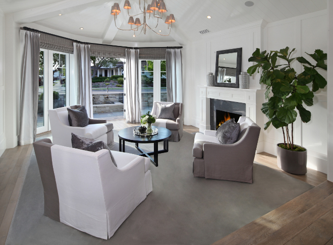 Living room chairs. Living room chairs. Living room with round seating. Lighting is from Circa Lighting. French doors open to the front porch. #Livingroom #chairs Brandon Architects, Inc