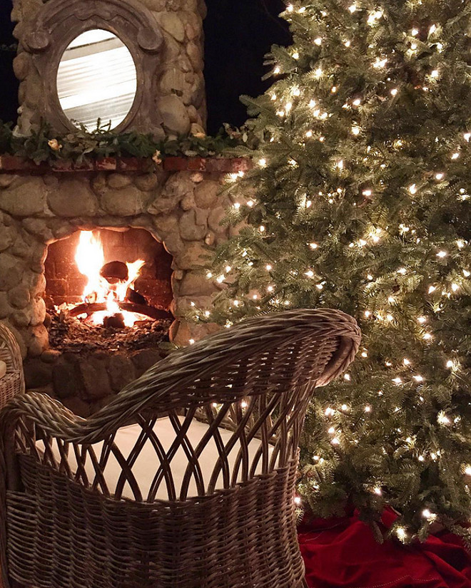 Patio Christmas Tree. Patio Christmas Tree by outdoor fireplace. Patio Christmas Tree #PatioChristmasTree French Country Cottage via Instagram @frenchcountrycottage