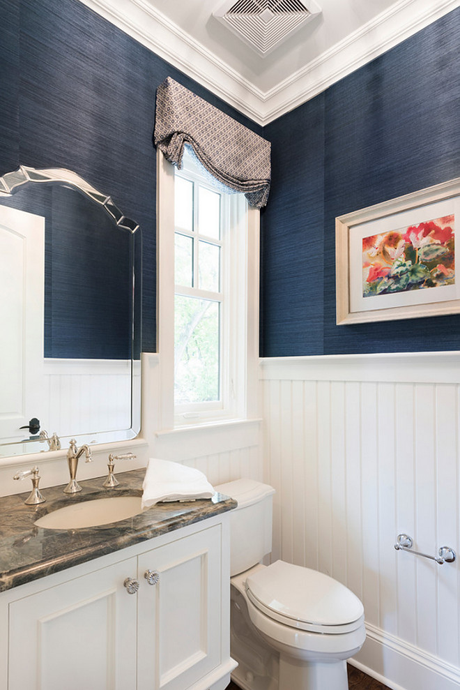 Powder room Wainscotting. Isn't this powder room inspiring? I love the classic white beadboard wainscotting against the navy walls. Powder room Wainscotting. Powder room Wainscotting Ideas. Powder room beadboard Wainscotting #PowderroombeadboardWainscotting #PowderroomWainscotting #beadboardWainscotting #beadboard #Wainscotting Stonewood LLC. Studio M Interiors. Spacecrafting Photography
