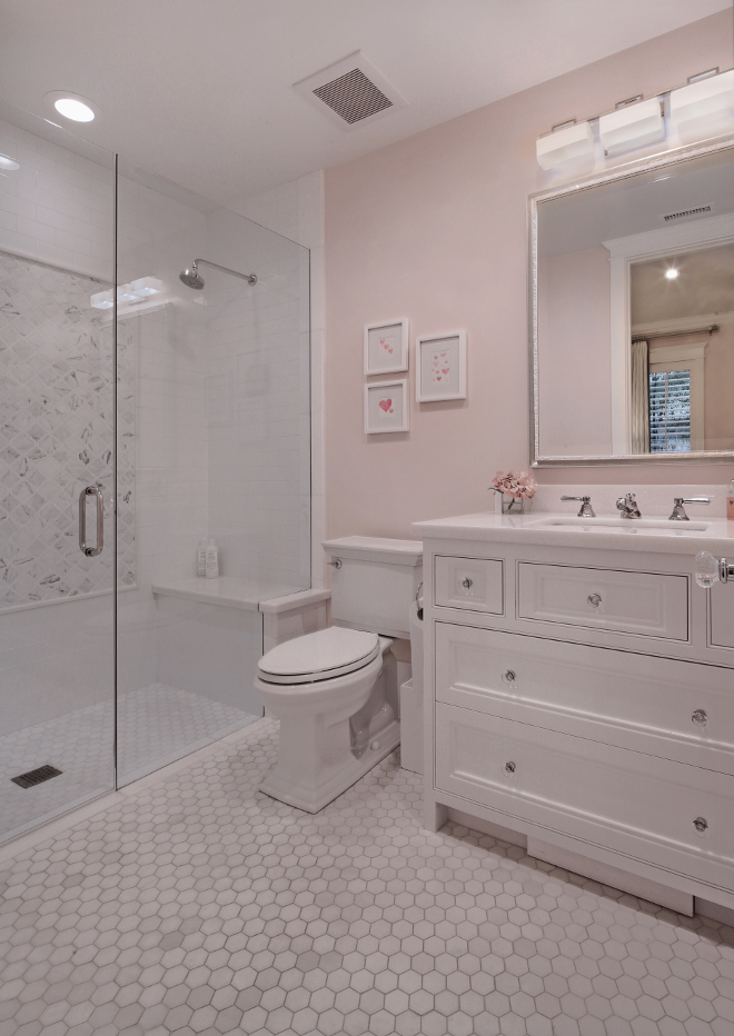 Small Bathroom. Hex floor tiles, white cabinet with glass knobs and pale pink walls create a timeless feel to this small bathroom. Small Bathroom. Small Bathroom #SmallBathroom Brandon Architects, Inc