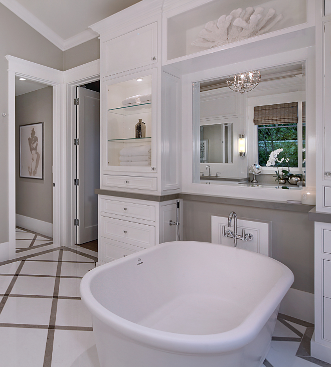 Tub Cabinet. How to add storage in your bathroom by the bathtub. I love freestanding bathtubs but I am not a big fan of the lack of storage around them. A cabinet anchoring the tub resolves this problem. Tub Cabinet Ideas #Tub #Cabinet #Bathroomcabinet Brandon Architects, Inc