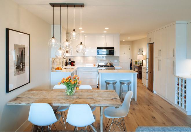 Apartment Lighting. Open feel apartment with modern lighting. The light fixture is a Firefly pendant light from CB2 Lighting. #ApartmentLighting #apartment #lighting Kenorah Design + Build Ltd
