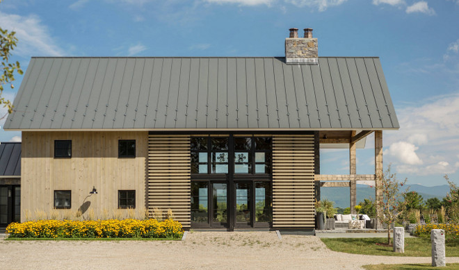 Barn Style Farmhouse. The farmhouse feature wood slat barn doors. Barn Style Farmhouse Exterior. Barn Style Farmhouse Architecture. Barn Style Farmhouse Design #BarnStyleFarmhouse #Barn #Farmhouse #Exterior #BarnFarmhouseArchitecture #FarmhouseDesign #BarnFarmhouses Roundtree Construction. TruexCullins Architecture + Interior Design