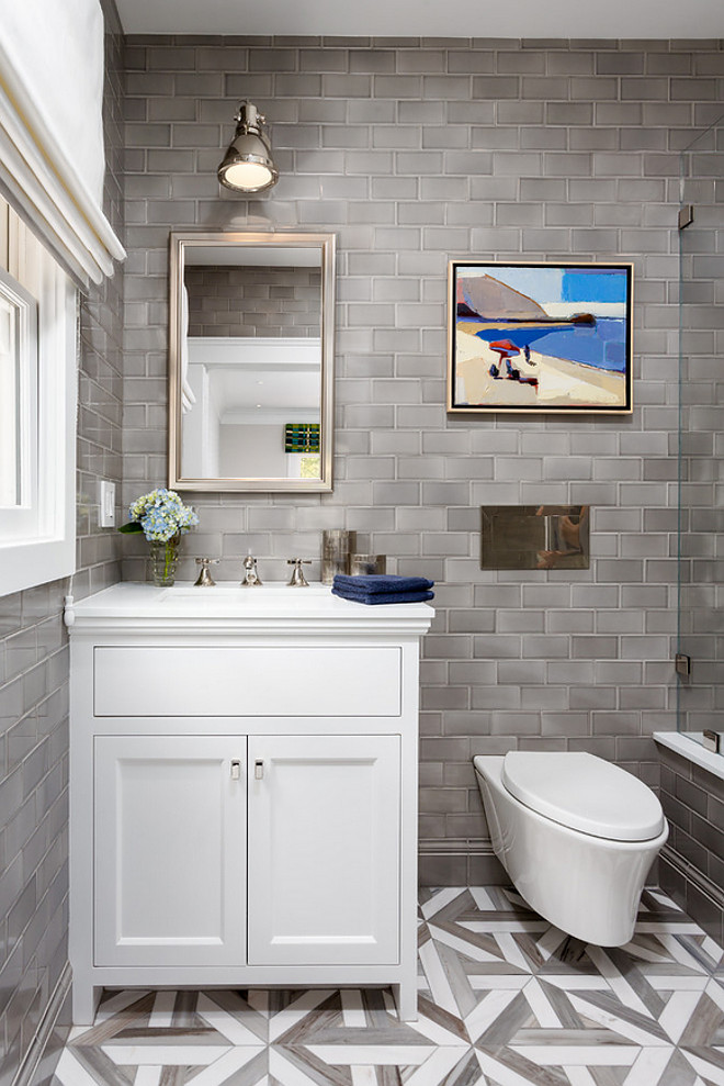 Bathroom renovation with grey subway tile. The tile installed in this bath was Sonoma Tilemaker's Stellar Collection and the color is Quicksilver Grey. Bathroom renovation with grey subway tile. Bathroom reno with grey subway tile #Bathroomrenovation #greysubwaytile #subwaytile Robert Frank Interiors