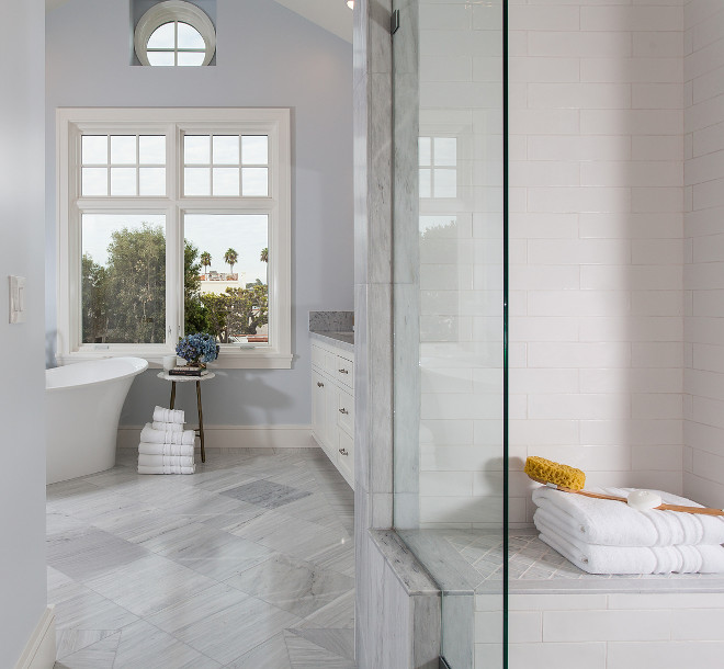 Bathroom tiling. A great combination of tiles can be found in this bathroom. Shower tile is undulated white subway tile. Bathroom floor tile and bathroom shower tile. The floor tile is Solto White Marble. #bathroomtiling #bathroom #tile #floortile #showertile Brandon Architects, Inc.