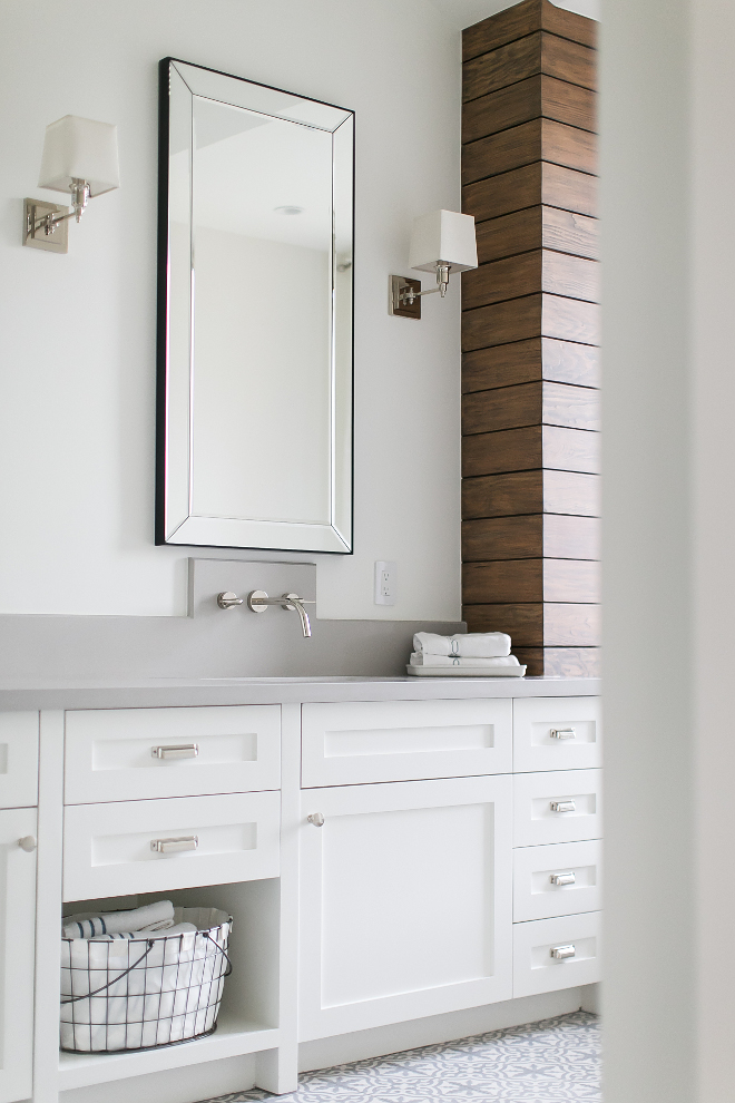 Bathroom with grey quartz countertop, wall-mount faucet, shiplap walls, cement tile and white cabinet. A mirror, from Restoration Hardware, a wall-mounted sink faucet, and the wood stained shiplap accent wall, make of this master bathroom vanity, one special place to get ready in the morning! #Bathroom #greyquartz #greyquartzcountertop #wallmountfaucet #shiplap #shiplapwalls #cementtile #whitecabinet Patterson Custom Homes