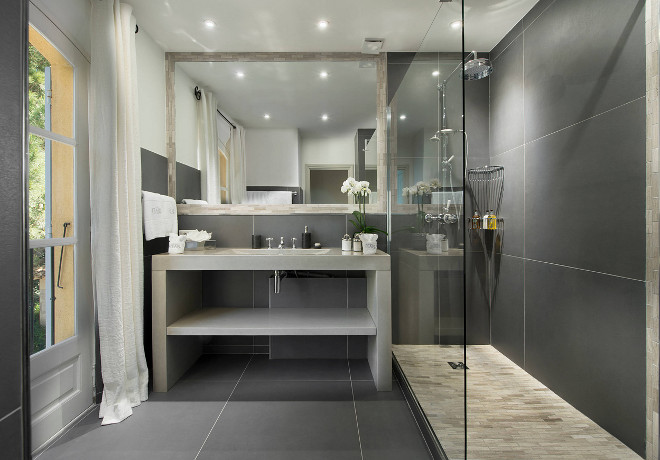 Bathroom with large floor and wall tile. The large stone tile is Natural stone basal grey Barwolf ( Point P). #Bathroom #largetile #floortile #walltile #bathroomtile #bathroomwalltile #bathroomshowertile #bathroomfloortile Pearl Interiors