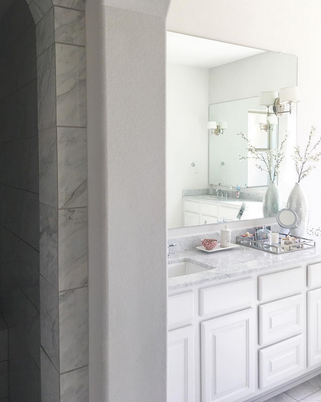 Bathroom. Bathroom. Countertop is polished white marble. Tile is a marble-looking porcelain tile from Arizona Tile. Bathroom #bathroom Beautiful Homes of Instagram: classicstylehome