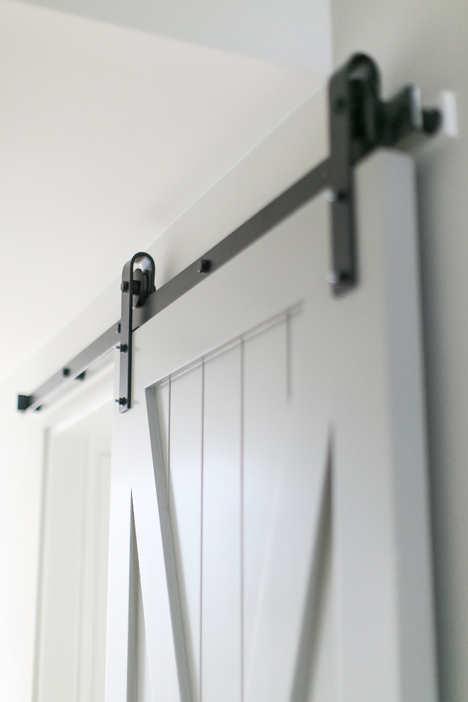 "Benjamin Moore HC-179 Platinum Gray. A sliding barn door with steel hardware acts as the perfect space divider between rooms. Grey Barn Door Paint Color: ""Benjamin Moore HC-179 Platinum Gray"". Benjamin Moore HC-179 Platinum Gray #BenjaminMooreHC179PlatinumGray #BenjaminMooreHC179 #BenjaminMoorePlatinumGray Patterson Custom Homes"