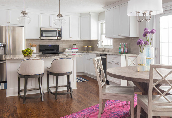 Benjamin Moore Simply White. Neutral white kitchen with pops of color. White cabinets are painted in Benjamin Moore Simply White. #BenjaminMooreSimplyWhite #NeutralKitchen