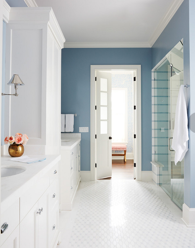 Blue and white bathroom. I love how clean and calm this blue and white bathroom feels. The bathroom is not huge but the designer worked very well with the square footage of this space. Tiles are from New Ravenna. Sconces are by Circa Lighting. Blue and white master bathroom. #Blueandwhitemasterbathroom #bathroom #masterbathroom Andrew Howard Interior Design