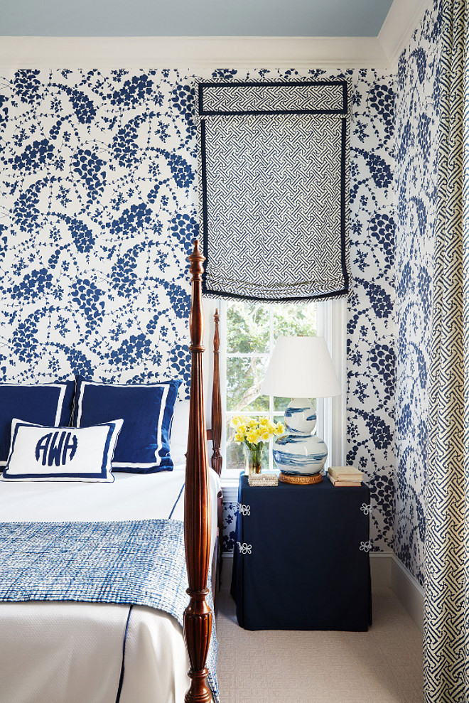 Blue and white bedroom. Bold Blue and white bedroom. Blue and white bedroom wallpaper. Blue and white bedroom wallpaper and blue ceiling. This guest bedroom is bold and chic. The window shade features a Quadrille's fabric - Java Grande. Wallpaper is also Quadrille. The blue and white lamp is from Bunny Williams Home. #Blueandwhitebedroom #Blueandwhitewallpaper #blueceiling #boldinteriors Andrew Howard Interior Design