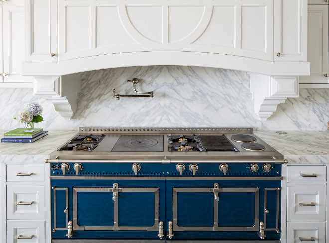 Blue range. French range. Backsplash is Calcutta Extra and the blue range is a French La Cornue range in cobalt blue. French La Cornue range in cobalt blue #FrenchRange #Bluerange #LaCornue #LaCornuerange #cobaltblue Martha O'Hara Interiors