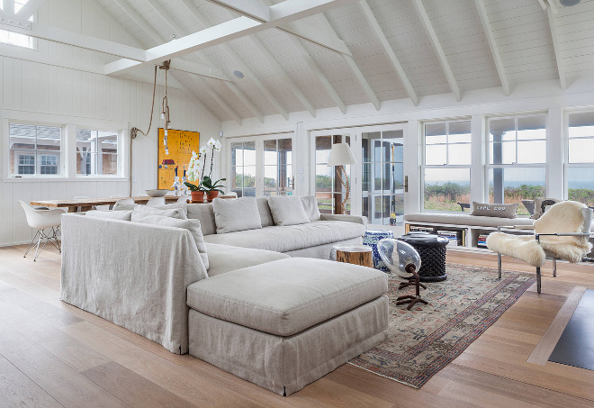 Cathedral Ceiling With Exposed Beams. White Cathedral Ceiling With Exposed Beams. open floor plan living room with cathedral ceiling design. A soaring vaulted ceiling in white with exposed beams hangs above this vast open-plan