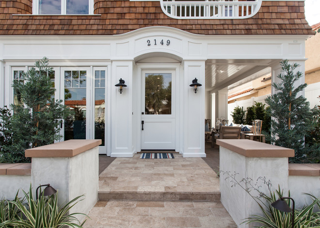 Coastal Home Front Door and Exterior Lighting. Coastal Home Front Door and Exterior Lighting ideas. Coastal Home Front Door and Exterior Lighting. The windows and doors are by Pella Windows. #CoastalHome #FrontDoor #ExteriorLighting Brandon Architects, Inc.