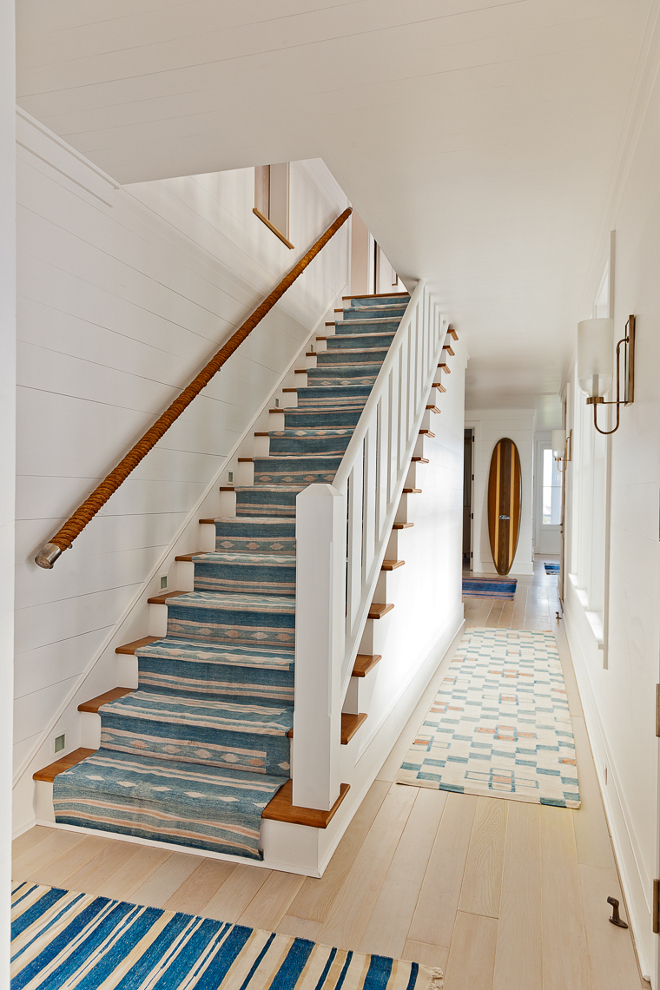Coastal Staircase. Coastal Staircase with rope railing, blue and white runner and blue and white stair runner. Coastal Staircase #CoastalStaircase #Rope #RopeRailing #blueandwhiterunner #runner #stairrunner Beau Clowney Architects. Jenny Keenan Design
