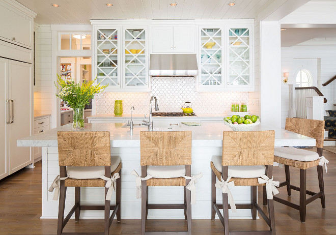 Coastal kitchen with crossed x upper cabinets and shiplap walls.