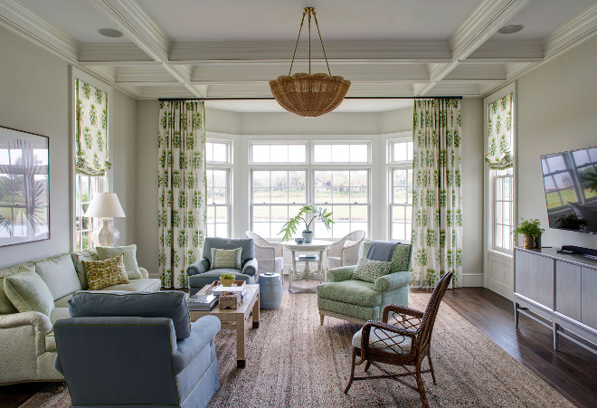 Family room. Grey walls family room with sisal rug and beautiful draperies and Roman shades. #Familyroom Andrew Howard Interior Design