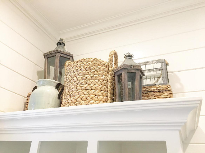 Farmhouse Decor. Accessories to bring a relaxed farmhouse look to your home. The lanterns, wicker baskets, and light blue jug are from Pottery Barn. #Farmhousedecor
