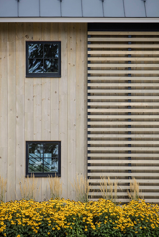 Farmhouse Exterior with Tongue and Groove Paneling and wood slats. Roundtree Construction. TruexCullins Architecture + Interior Design