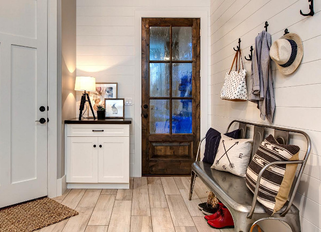 Farmhouse Mudroom. Modern Farmhouse mudroom with shiplap walls and glass door. #FarmhouseMudroom #FarmhouseMudroomIdeas #FarmhouseMudroomDesign #Farmhouse #Mudroom #ModernFarmhouse #ModernFarmhouse #ModernFarmhousemudroom #mudroom #shiplap #glassdoor Timberidge Custom Homes