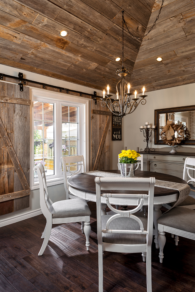 Farmhouse dining room furniture. A set of barn doors complements the rustic ceiling. Barn door track hardware: Richards-Wilcox. Farmhouse dining room furniture ideas. Farmhouse dining room furniture #Farmhouse #diningroomfurniture Hardcore Renos