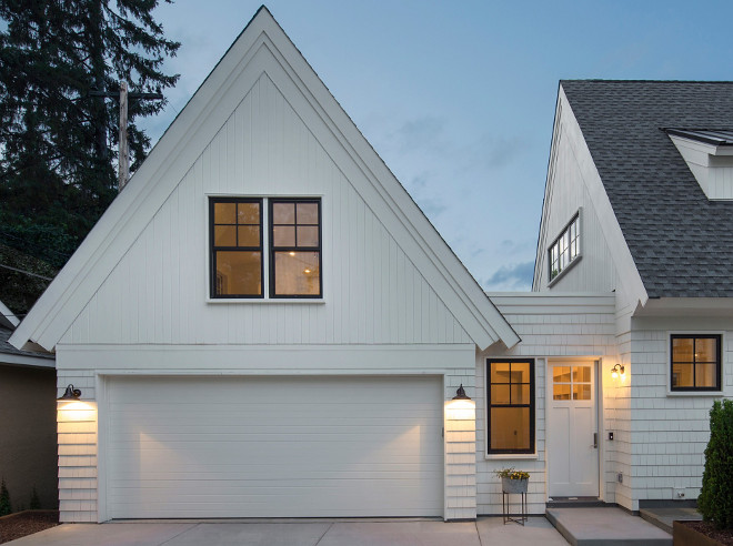 Garage Design. White garage with enclosed breezeway, barn light sconces, bonus room above garage and black steel windows. #GarageDesign #Whitegarage #enclosedbreezeway #garagebreezeway #breezeway #barnlightsconces #bonusroomabovegarage #garageblacksteelwindows #blacksteelwindows Keller Architecture.