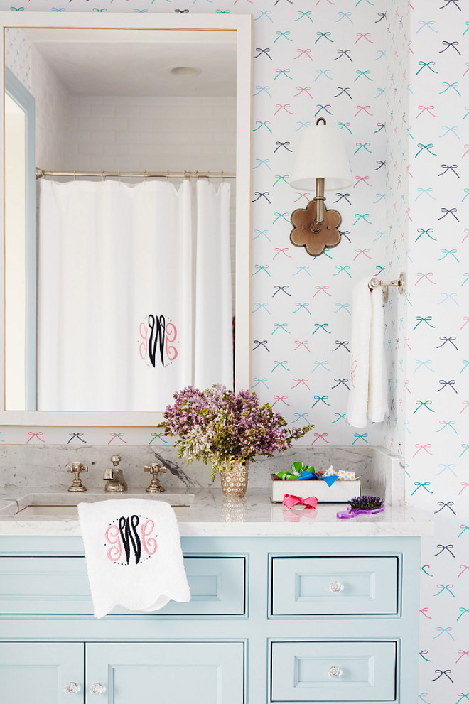 "Girls Bathroom. Girls Bathroom with light turquoise vanity and bow wallpaper. The light turquoise vanity works perfectly with the Dabney Lee's bow wallpaper. The light turquoise paint color used on the vanity is ""Benjamin Moore 2123-50 Ocean Air"". Girls Bathroom. Girls Bathroom with light turquoise vanity and bow wallpaper ideas #GirlsBathroom #GirlsBathroomwallpaper #lightturquoisevanity #bowwallpaper #BenjaminMoore212350OceanAir #BenjaminMoore212350 #BenjaminMooreOceanAir Andrew Howard Interior Design"