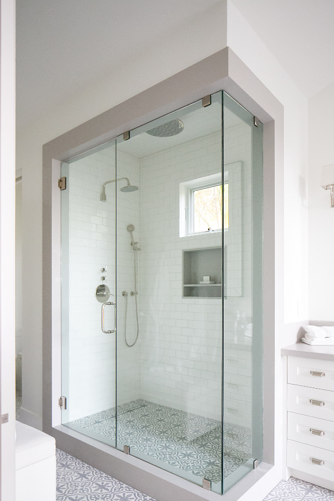 "Bathroom frameless glass shower door. This bathroom features a frameless glass shower door and accompanying panel 1/2"" thick fully enclosed by a shower jamb that matches the stone at the bathroom's vanity. #Bathroom #framelessglassshowerdoor #glassshowerdoor Patterson Custom Homes"