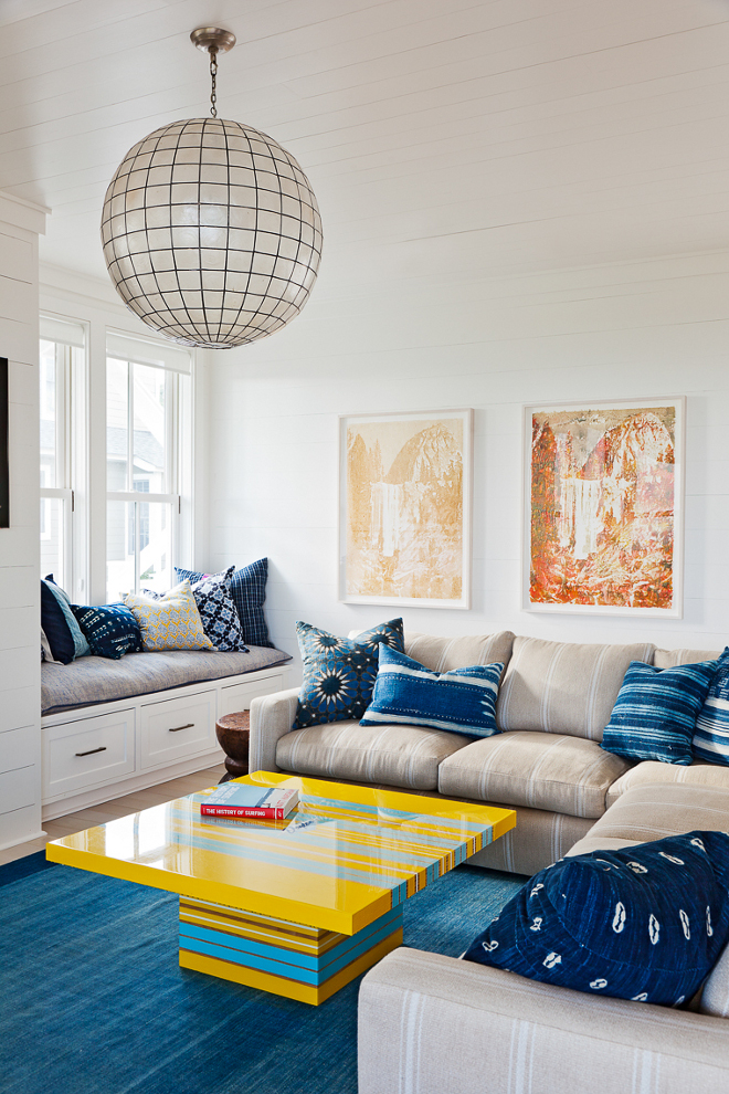 Globe pendant light. This kid's family room is all about color and that outrageously gorgeous capiz shell globe pendant. Large globe pendant light. Globe pendant light ideas #globependantlight Beau Clowney Architects. Jenny Keenan Design