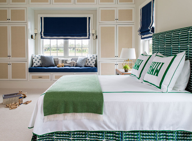 Green and Navy Bedroom. Beautiful and bold bedroom color scheme with green and navy fabrics. This green and navy color scheme is incredible and the built-in closet is a dream for any mom! The bed fabric is by Schumacher. #GreenandNavy #Bedroom #BeautifulBedroom #boldcolorscheme #bedroomcolorscheme #fabrics Andrew Howard Interior Design