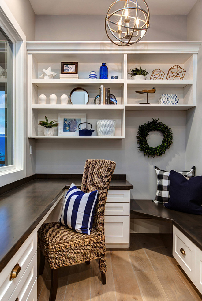 Home Office Built ins. Modern Farmhouse home office with built ins and blue and white decor. This home office by the kitchen is a great little space to enjoy the views and answer to emails. #Homeoffice #Smallhomeoffice #homeofficebuiltins #builtins Timberidge Custom Homes